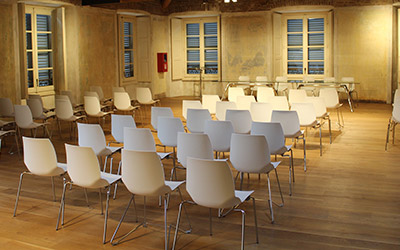empty chairs lined up in a conference room