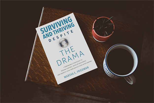 Surviving and Thriving by Marsha Freidman sitting on side table with coffee mug